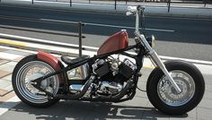 Yamaha V-Star 650 softail custom with diamon-stitch solo seat, window bars, fork lowers and sportster tank