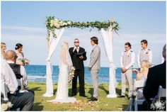 Wedding ceremony with twisted willow archway and ivy