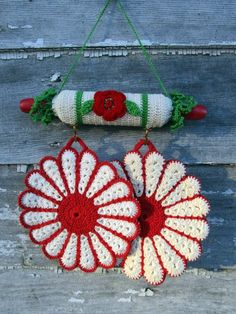 Here for your consideration is a cute little pot holder hook with potholders. The hook is made from a toy size rolling pin with a crochet cover.