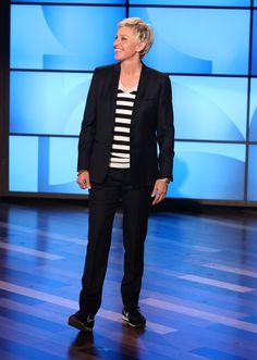 Ellen's Look of the Day: Alexander McQueen sweater; custom suit; Nike sneakers.