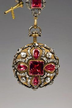 Marie Antoinette's Gold watch and chatelaine with diamonds and rubies.