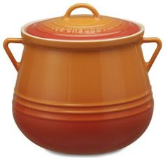 Le Creuset Stoneware Bean Pot -- The orange is funky and fun for Fall but imagine if it came in purple!