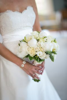 Classic white bouquet featuring peonies, garden roses, and greenery {Photo by Cramer Photo via Project Wedding}