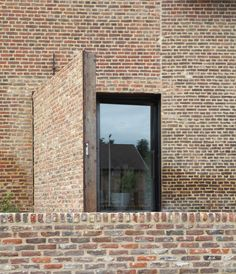 Lens°Ass architecten---Great Door Made of Bricks Blending into the Facade
