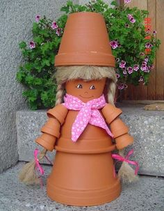 DIY garden idea clay pots diffrent sizes doll