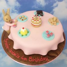 The Cake Store - Bunny's Tea Party Cake, £140.00 (https://www.thecakestore.co.uk/bunnys-tea-party-cake/)