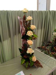 Beautiful table centre piece. Peach roses on rustic bark.