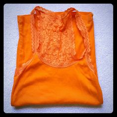 Hollister lace tank top Bright orange tank top with pretty lace detail on straps and back. Fabric is a cotton blend and soft. Super fun bright color, great for summer! Size XS. Gently worn once, still looks new. Hollister Tops Tank Tops