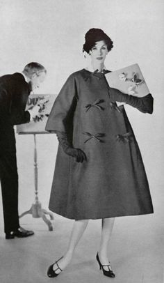 In 1958 Yves Saint Laurent designed for Dior and he came up with the trapeze dress. This dress was very different from the usual body conscious styles that were popular in the 50's. This is one of the styles that led us into the 60's. (Allison M)