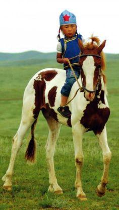 A little Mongolian girl on horse.