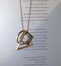 Brass triangle, circle and square necklace.