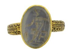Ancient Roman grey chalcedony signet ring of Zeus, 2nd century AD.