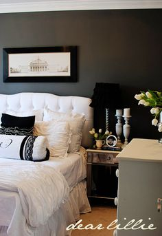 charcoal gray walls - white bedding -