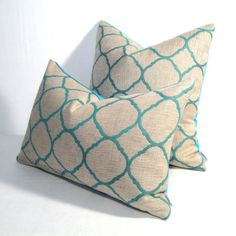 Modern and sophisticated antique white and turquoise blue, Ogee indoor outdoor pillow sewn in Sunbrella fabric.  #mazizmuse #ModernOutdoorPillows