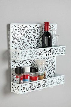 This cutout spice rack would be so cute for the bathroom for nail polish or other cosmetics. Also a neat idea for wine.