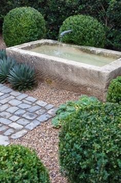 Another view of this simple stone water feature which I pinned yesterday. I like the gravel and the granite paving blocks.