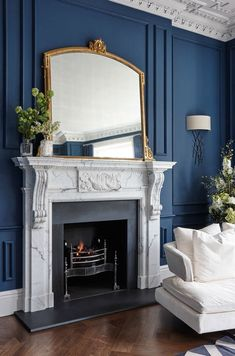 11 Fabulous Fireplace Examples - Town & Country Living : Gorgeous Marble Fireplace in Navy Blue Living Room Living Room With Fireplace, Home Living Room, Living Room Designs, Navy Blue Living Room, Blue Rooms, Blue Room Decor, Navy Blue Decor, Living Room Decor Curtains, Marble Fireplaces