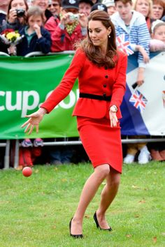 Kate and William hit Christchurch on their tour to help publicize the Cricket World Cup. Ever the good sport, the Duchess batted and took to the field in her scarlet red skirt suit and court heels.