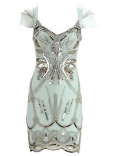 Soft mint dress with silver accents.