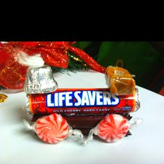 Candy train Christmas decoration/craft- I would wrap the carmel and the lifesavers to make it more cohesive, color-wise.