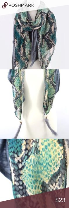 """B27 Reptile Print 2 Layer Blue Green Feather Scarf ‼️ PRICE FIRM UNLESS BUNDLED WITH OTHER ITEMS FROM MY CLOSET ‼️    Absolutely gorgeous & stunning scarf.  Two part.  Shades of blues, greens and teal  reptile print on one part and a stretch blue heather fabric on the other.  Beading and a natural feather on each end.  Please check my closet for many more scarves and clothing items.  Length 42""""  Width 35"""" Accessories Scarves & Wraps"""