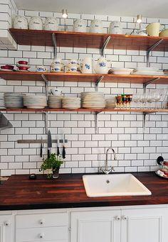 Lovely kitchen, open shelves, butcher countertop, white subway tile dark grout