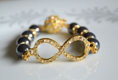 Black pearl and rhinestone gold infinity bracelet by starrydreams, $45.00