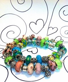 Pandora Murano bracelets. My next bracelet is gonna be lime and pink!