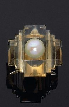 An Art Deco citrine and pearl ring, by René Boivin, circa 1930. Unsigned…