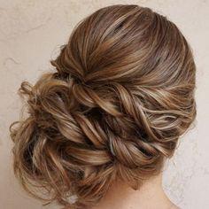 Trendy twisted back updo wedding hairstyle; Featured Hairstyle: Heidi Marie Garrett