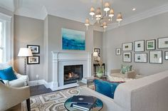 Living room with light gray walls paint color (Abalone).