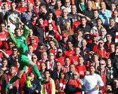 Unfazed by the hoards of Liverpool fans watching on, @manutd's David De Gea leaps to take possession of the ball.