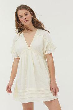 Shop UO Venus Cotton Smock Mini Dress at Urban Outfitters today. Frock Dress, Midi Shirt Dress, Floral Midi Dress, Urban Outfitters Women, China, Necklines For Dresses, White Mini Dress, Urban Dresses, Sleeve Designs
