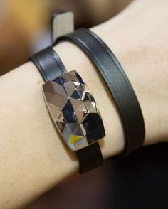 The June bracelet has a jewel that tells the wearer when she's been too exposed to the sun, and measures UV intensity.