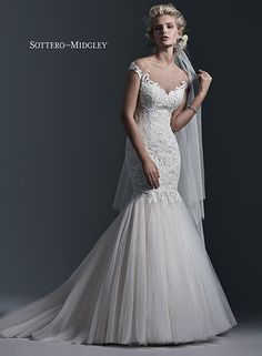 Bold patterned lace, a stunning illusion neckline and full, voluminous skirt... Cassandra by Sottero and Midgley.