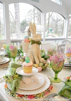 Spring Tablescape. I love the vases full of tulips flanking the ...