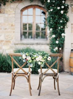 Rustic crossback chairs are perfectly complemented by floral decoration. For more information on how we could recreate this image visit www.stressfreehire.com or contact info@stressfreehire.com
