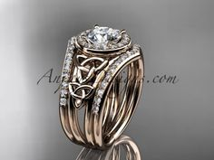 "14kt rose gold diamond celtic trinity knot wedding ring, engagement ring with a ""Forever One"" Moissanite center stone and double matching band CT7131S"
