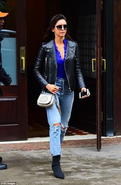 815279e2a0a Nina Dobrev hits the streets in leather jacket and ripped jeans