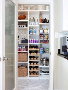 This pantry is outfitted with a modular system, similar to what you'd see in a clothing closet. Shelves designed to hold shoes, purses, and folded sweaters are just as capable of storing bottled drinks and pantry extras. Outfit a section of the system with a wine rack to store your collection.