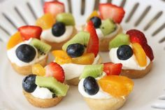 For a sweeter appetizer here are some mini fruit pizzas!  The ingredients used here are all store bought, Pillsbury sugar cookie dough (but you might be able to get away with your own recipe)  8 oz cream cheese, large container of cool whip, and 4 cups of fruit of your choice.  For prep the recipe calls for mini muffin tins and makes approximately 48 servings.