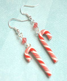 These earrings feature a pair of handmade candy canes made from polymer clay. Each measures an inch long and hangs from a nickel free, silver tone hook. SKU 1069                                                                                                                                                                                 More