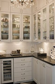 I love the little doors above the cabinets! That space is such a waste, but with these, it's usable! Great idea!