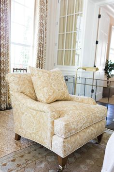Gracious Club Chairs - Idea House Living Room by Mark D. Sikes - Southernliving. These Henredon armchairs offer a variety of seating throughout the room, and guests can have an intimate conversation with the person across or a larger conversation with guests sitting on the sofa.