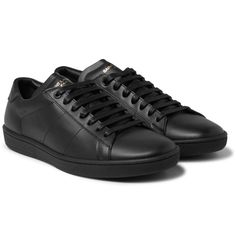 <a href='http://www.mrporter.com/mens/Designers/Saint_Laurent'>Saint Laurent</a>'s sleek black sneakers have been impeccably crafted in Italy from smooth leather. This low-top pair has no extraneous detailing, save for the gold stamp on the tongues. Smooth linings and rubber soles ensure they're comfortable and stylish in equal measure. Wear yours with everything from suits to sweatpants.