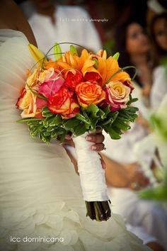 beach wedding bouquet with orange lilies and roses