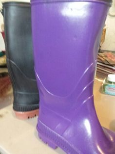 You can paint rubber boots with Valspar Duramax paint.  You can get it in a rainbow of colors at Lowes.