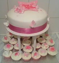 Butterfly and flower cake and cupcakes