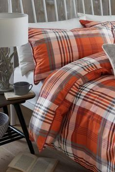 If you're yet to kit out your home with those warm Autumnal colours, get in season with this Brushed Cotton Orange Check Bed Set from Next.