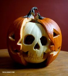 This site has some really good ideas for Halloween decor! Pumpkin with white pumpkin skull inside.